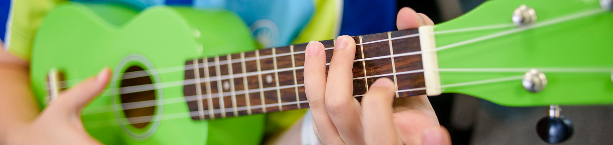 student playing ukulele